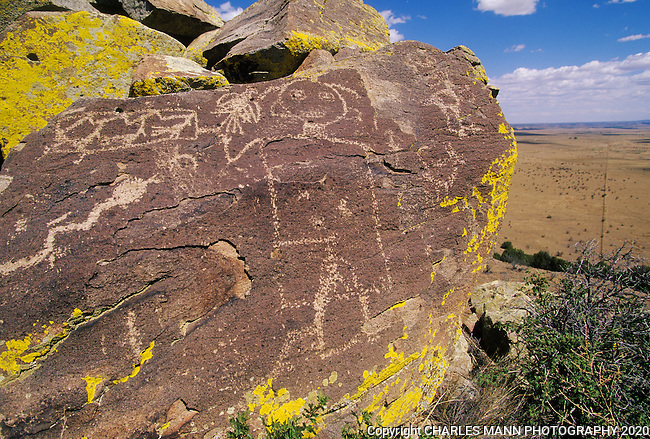 A petroglyph figure seems to float in a timeless scene above the terrain of the Galesto River Basin near the village of Galesteo, New Mexico
