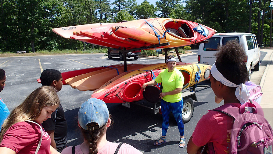 NWA Democrat-Gazette/FLIP PUTTHOFF <br />Chelsea Porter, interpreter at Hobbs State Park-Conservation Area, shows campers    July 2018   the kayaks they will paddle in Van Winkle Hollow.