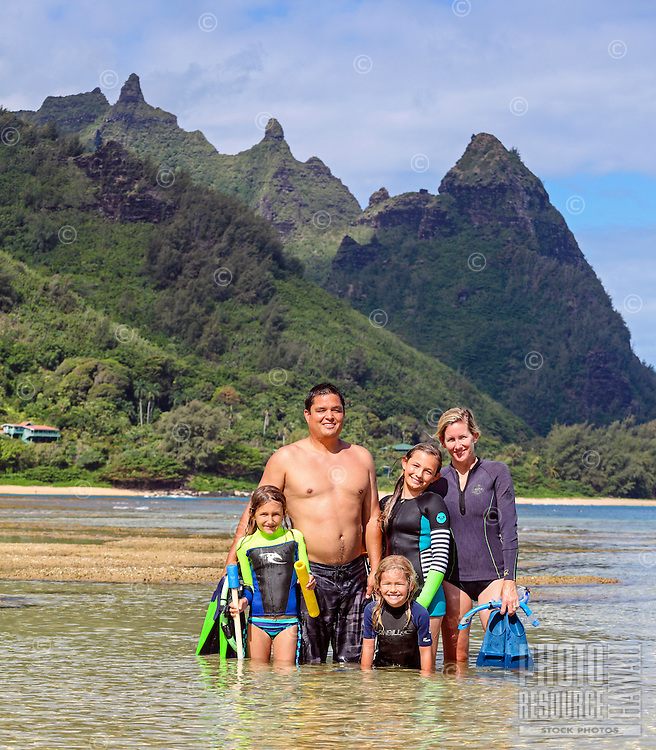 A family day of snorkeling at Tunnels Beach, Kaua'i.