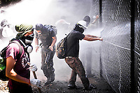 Demonstrators fight during a protest against the construction of a high-speed train line, Treno Alta Velocita (TAV), in Chiomonte, north of Turin July 03, 2011. <br /> The TAV, which will link Turin in Northern Italy to Lyon in France, will pass through the villages and towns of the demonstrators also called No Tav, who are protesting for the economical impact and environmental reasons.
