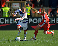 11 April 2009:  FC Dallas defender Michael Dello-Russo #2 and Toronto FC forward Chad Barrett #19 in action during an MLS game at BMO Field in Toronto between FC Dallas and Toronto FC. The game ended in a 1-1 draw.