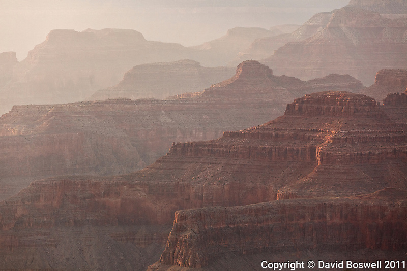 Strong winds bringing a dusty haze that blankets the Grand Canyon.