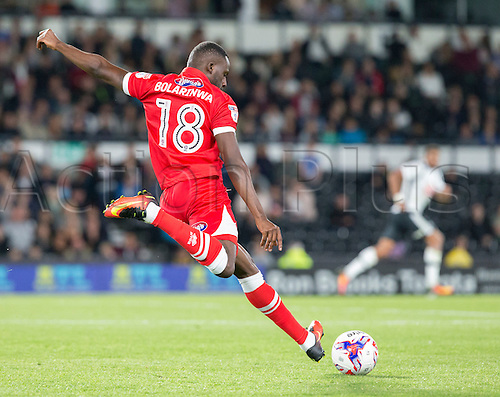 09.08.2016. iPro Stadium, Derby, England. Football League Cup 1st Round. Derby versus Grimsby Town. Grismby Town midfielder Tom Bolarinwa crossing the ball into the Derby box.