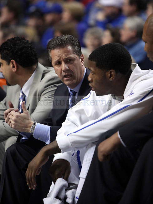 UK head coach John Calipari talks with DeAndre Liggins in the first half of UK vs. Florida  at Rupp Arena on Saturday, Feb. 26, 2011.  Photo by Britney McIntosh | Staff