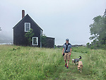 The author and his dogs walking on the North End of Vinalhaven.<br /> <br /> Photo: Moira Trachtenberg
