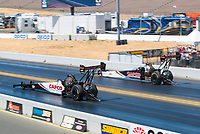 Jul 28, 2019; Sonoma, CA, USA; NHRA top fuel driver Steve Torrence (near) races alongside father Billy Torrence during the Sonoma Nationals at Sonoma Raceway. Mandatory Credit: Mark J. Rebilas-USA TODAY Sports