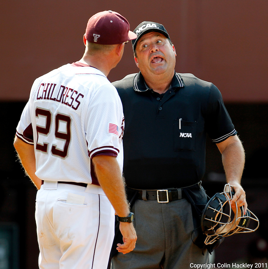 TALLAHASSEE, FL 10-FSU-TAMUBASE11 CH-Texas A&M Head Coach Rob Childress contests a call with Home Plate Umpire Mark Chapman Sunday at Dick Howser Stadium during NCAA Super Regional action in Tallahassee. The Seminoles beat the Aggies 23-9 to stay alive in the best of three series...COLIN HACKLEY PHOTO