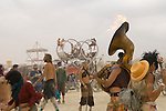 Flaming tuba performance art in center camp at the Burning man arts and counter culture festival in the Black Rock desert near Gerlach, NV, 2009