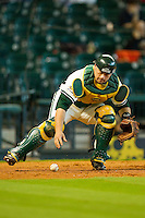 Catcher Josh Ludy #30 of the Baylor Bears chases down a wild pitch against the Utah Utes at Minute Maid Park on March 5, 2011 in Houston, Texas.  Photo by Brian Westerholt / Four Seam Images