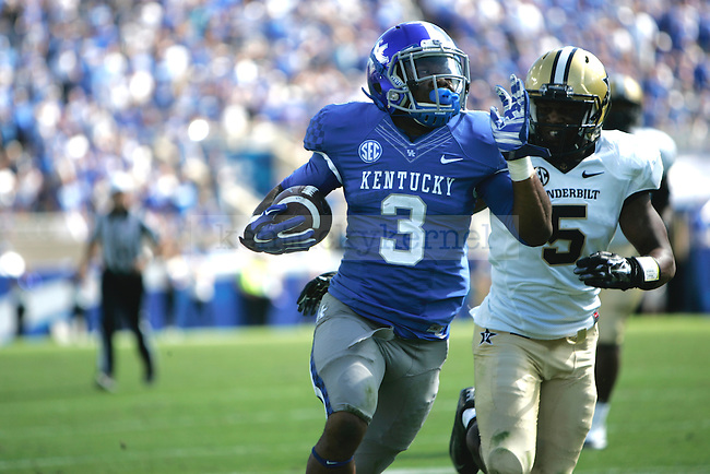 Running Back, JoJo Kemp (3) out runs defender on a long gain during the second half against the Vanderbilt University Commodores at Commonwealth Stadium on Saturday, September 27, 2014 in Lexington, Ky. Kentucky defeated Vanderbilt 17-7. Photo by Joel Repoley | Staff