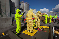 Paramedics in HAZMAT suits gets hosed down and cleaned before undressing at the other side. HarbourEx15, a field training exercise with scenarios connected to operations in the harbor April 27th – 29th 2015.<br /> <br /> The scenario of the exercise is a major accident on Sydhavna /Sjursjøya area of Oslo, and will involve rescue and emergency response agencies from tactical to strategic level. (photo: Fredrik Naumann/Felix Features)