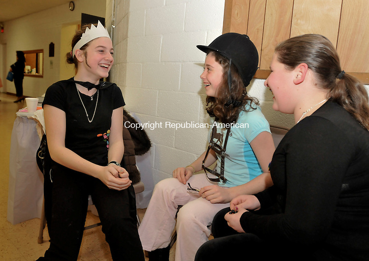 TORRINGTON, CT-030909JS01-Miriam Jenkins, 11, of Litchfiled, left, shares a laugh with Laurie Denenholtz, 11, of New Hartford and Alyssa Pelosi, 11, of Thomaston following the Purim celebration Monday at the Beth El Synagogue in Torrington. The festival of Purim commemorates the deliverance of the Jewish people of the ancient Persian Empire from Haman's plot to annihilate them, as recorded in the Biblical Book of Esther.<br /> Jim Shannon  Republican-American