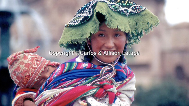 Quechua mother with child, Cuzco, Peru