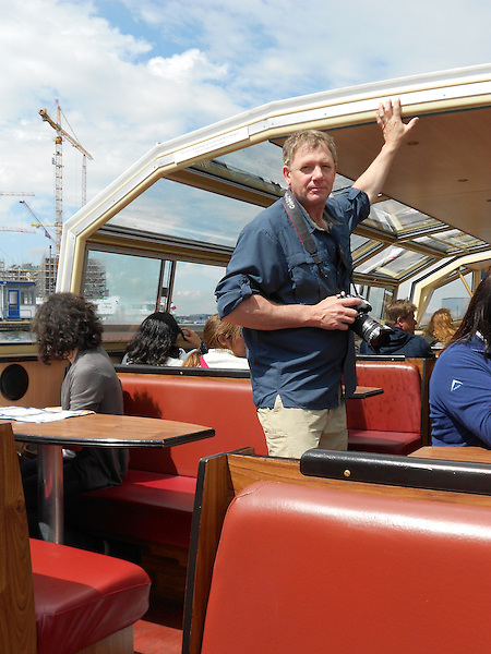 John in a canal tour boat in Amsterdam, Netherlands.