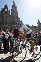 Alberto Contador passes by the front of the Obradoiro of the Cathedral of Santiago de Compostela before the stage of La Vuelta 2012 between Santiago de Compostela and Ferrol.August 31,2012. (ALTERPHOTOS/Acero)