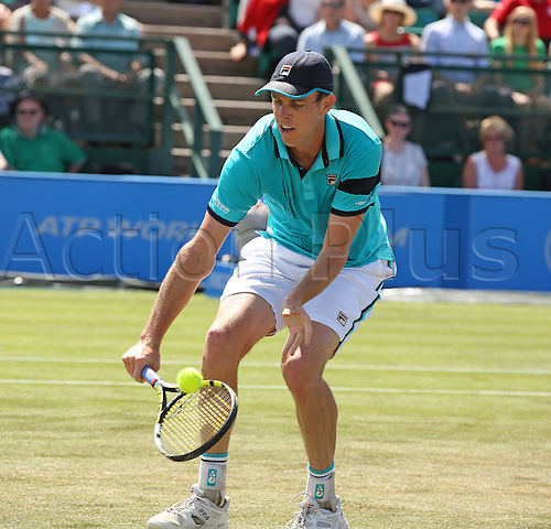27.06.2015.  Nottingham, England. Aegon Nottingham Open Tennis Tournament. Backhand volley from Sam Querrey (USA) in the final
