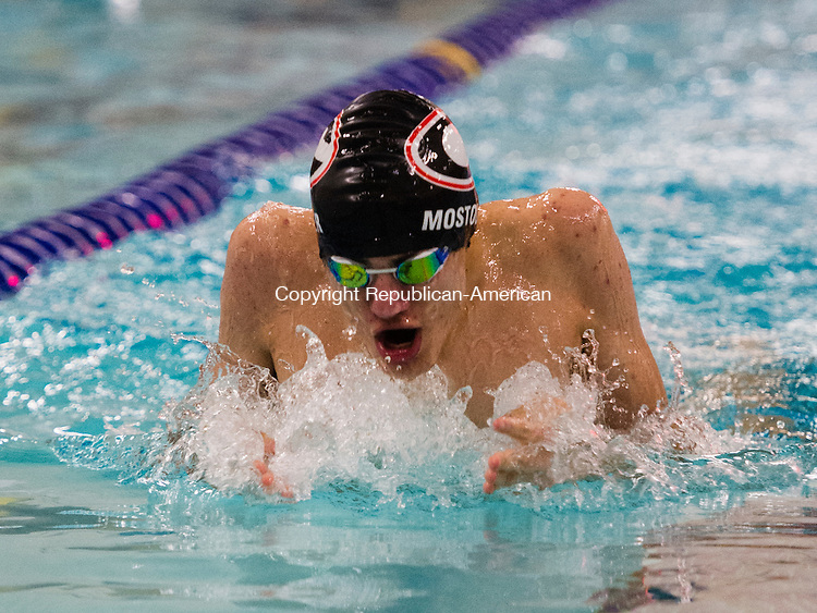 WATERBURY, CT- 4 January 2015-010416EC06-   Cheshire's Ryan Mostoller wins the 100 Breastroke against Holy Cross at Kennedy High School Monday night. His time was 1:03.78. Erin Covey Republican-American