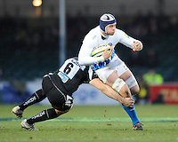 Dave Attwood of Bath Rugby (centre) is tackled by David Ewers of Exeter Chiefs during the LV= Cup match between Exeter Chiefs and Bath Rugby at Sandy Park Stadium on Sunday 5th February 2012 (Photo by Rob Munro)