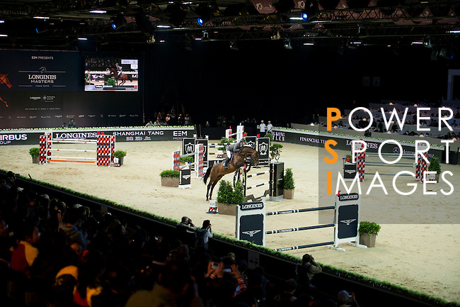 Ludger Beerbaum on Chaman competes during the Table A with Jump-off 145 - Airbus Trophy at the Longines Masters of Hong Kong on 20 February 2016 at the Asia World Expo in Hong Kong, China. Photo by Li Man Yuen / Power Sport Images