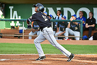 Sergio Alcantara (11) of the Missoula Osprey at bat against the Ogden Raptors in Pioneer League action at Lindquist Field on August 4, 2014 in Ogden, Utah.  (Stephen Smith/Four Seam Images)