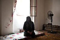 Lebanon - Tripoli - Badiah, 51-year-old, comes from the neighborhood of Bab Drieb, in Homs. She arrived in Lebanon two months ago, after the army stormed into her house and arrested on of her sons. One of her sisters was so shocked by the event that she went into a coma and suffered brain damages. ?I am here in Lebanon only to treat my daughter?, she explains. Badiah has left her husband and two other sons in Homs, where they still live in their house, partially destroyed by the shellings. ?There is just one safe room remaining, they sleep and live there?