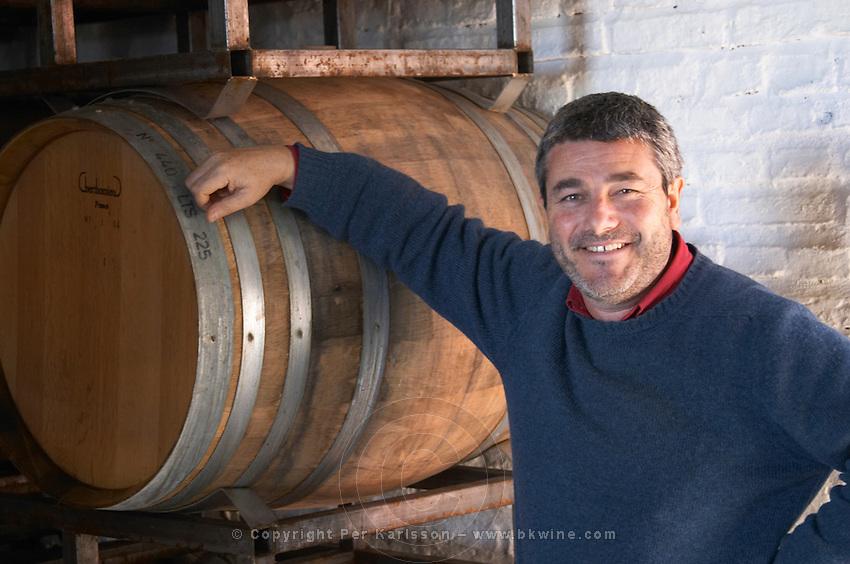 Eduardo Pisano one of the brothers Pisano in the barrel aging cellar. Bodega Pisano Winery, Progreso, Uruguay, South America