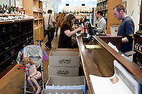 Customers shop for wine at Chambers Street Wines in New York, NY, USA, 22 May 2009. The store specializes in naturally made wines from artisanal small producers and has received a Slow Food NYC Snail of Approval.