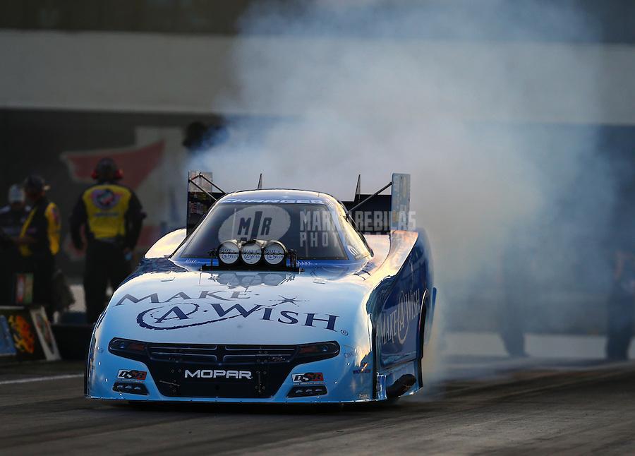 Sep 18, 2015; Concord, NC, USA; NHRA funny car driver Tommy Johnson Jr during qualifying for the Carolina Nationals at zMax Dragway. Mandatory Credit: Mark J. Rebilas-USA TODAY Sports
