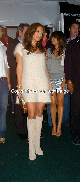 Jennifer Lopez ..at The Tommy Hilfiger Fashion Show for Spring 2005 at ..The Tents on September 9, 2004...Photo by Robin Platzer, Twin Images
