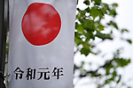 A Japanese flag with kanji characters depicting the first year of Reiwa is displayed along a street in Tokyo, Japan on May 1, 2019, the first day of the Reiwa Era. (Photo by MATSUO.K/AFLO)