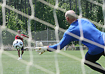 Landon Donovan (in red) practices shooting against goalkeeper Marcus Hahnemann (in blue) on Wednesday, May 17th, 2006 at SAS Soccer Park in Cary, North Carolina. The United States Men's National Soccer Team held a training session as part of their preparations for the upcoming 2006 FIFA World Cup Finals being held in Germany.