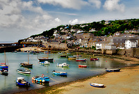 Mousehole Harbor and twon. Cornwall, England