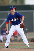 Collin Wiles #47 of the AZL Rangers pitches against the AZL Reds at Surprise Recreation Campus on July 24, 2012 in Surprise, Arizona. Rangers defeated Reds 3-1. (Larry Goren/Four Seam Images)