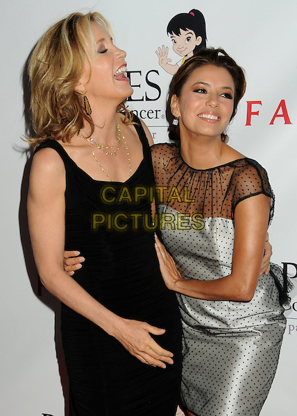 FELICITY HUFFMAN & EVA LONGORIA PARKER .25th Annual Padres Contra El Cancer Benefit Gala held at The Hollywood Palladium, Hollywood, California, USA, 23rd September 2010..half length silver dress arm around funny laughing smiling  gold beads necklace black sheer see thru through layered polka dot .CAP/ADM/BP.©Byron Purvis/AdMedia/Capital Pictures.