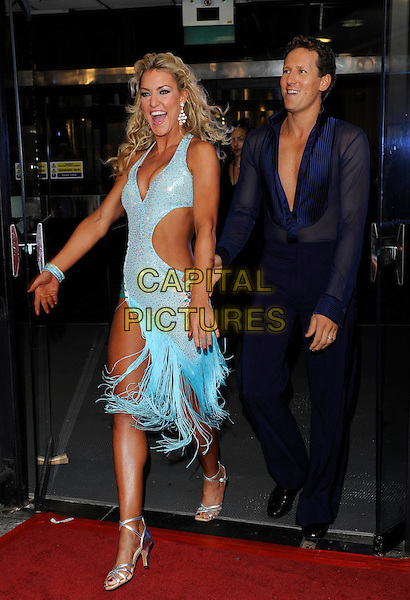 NATALIE LOWE & BRENDAN COLE.'Strictly Come Dancing' Launch Event at BBC Studios, London, England..September 7th 2011.full length blue dress side cut out away sheer shirt trousers mouth open walking .CAP/FIN.©Steve Finn/Capital Pictures.