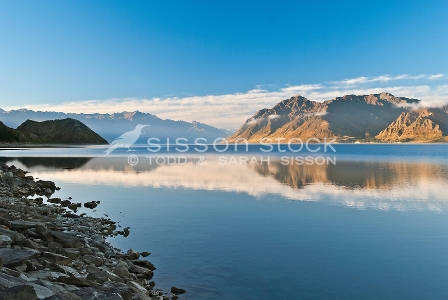 Mountains reflected in Lake Hawea at sunset, South Island, New Zealand