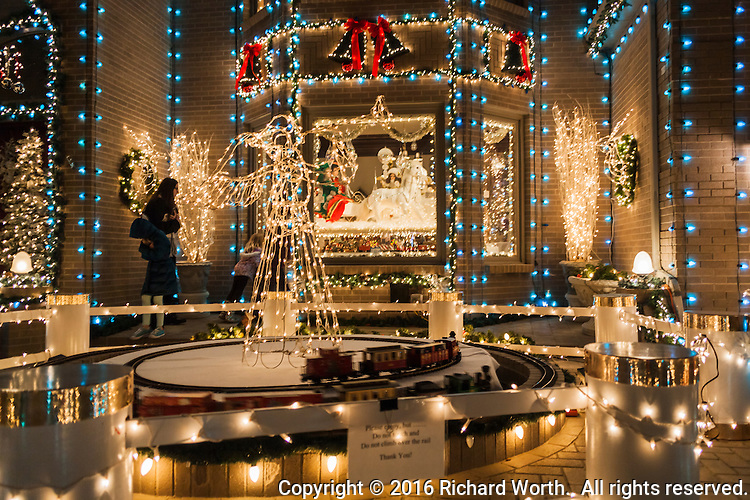 So very many lights.  So very many details:  from the model trains circling outside to the horse drawn sleigh inside.