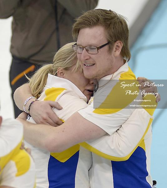 Swedish coach Eva Lund celebrates with Viktor Kjaell (SWE).  (SWE). Mens curling - Bronze medal match - SWE v CHN - Ice Cube Curling Centre - Olympic Park - PHOTO: Mandatory by-line: Garry Bowden/SIPPA/Pinnacle - Photo Agency UK Tel: +44(0)1363 881025 - Mobile:0797 1270 681 - VAT Reg No: 768 6958 48 - 210214 - 2014 SOCHI WINTER OLYMPICS - Ice Cube Curling Centre, Sochi, Russia