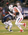 Nevada's Nigel Haikins (23) tackles Fresno State running back Josh Quezada (20) during the second half of an NCAA college football game in Reno, Nev., on Saturday, Nov. 22, 2014. Fresno State won 40-20. (AP Photo/Cathleen Allison)