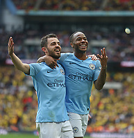 Manchester City's Raheem Sterling celebrates scoring his side's fifth goal with Bernardo Silva<br /> <br /> Photographer Rob Newell/CameraSport<br /> <br /> Emirates FA Cup Final - Manchester City v Watford - Saturday 18th May 2019 - Wembley Stadium - London<br />  <br /> World Copyright © 2019 CameraSport. All rights reserved. 43 Linden Ave. Countesthorpe. Leicester. England. LE8 5PG - Tel: +44 (0) 116 277 4147 - admin@camerasport.com - www.camerasport.com