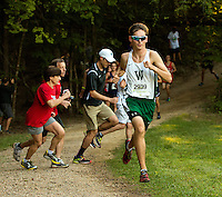 Photography of the Woodlawn School Varsity Cross Country team running Saturday morning  September 19, 2015, during the Annual Hare & Hounds Invitational race at McAlpine Greenway Park in Charlotte, NC<br /> <br /> Charlotte Photographer - PatrickSchneiderPhoto.com