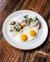 Buttermilk biscuits & sausage gravy with 2 eggs at Julep Restaurant, in Denver, Colorado, Friday, July 20, 2018. <br /> <br /> Photo by Matt Nager