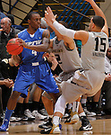SIOUX FALLS, SD - MARCH 10:  Frank Gaines #4 of IPFW shields the ball from Oakland University defenders Dante Williams #2 and Drew Valentine #15 during their quarterfinal game at the 2013 Summit League Basketball Championships at the Sioux Falls Arena Sunday. (Photo by Dick Carlson/Inertia)