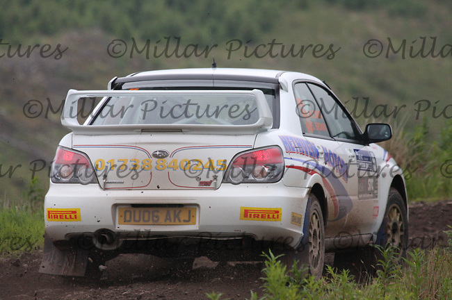 Martin Craik - Steven Brown in their Subaru Impreza near Junction 6 on SS1 Ae East.....