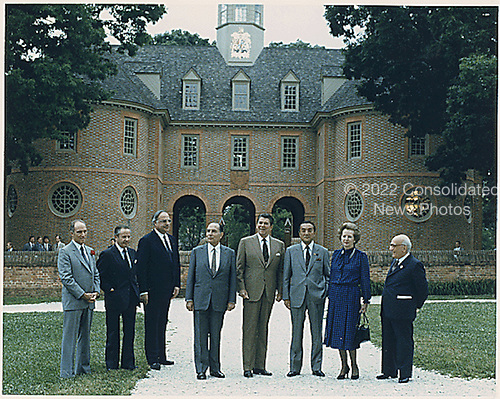 """Williamsburg, VA - May 29, 1983 -- """"Class photo"""" of the G-7 leaders from the  Economic Summit in Williamsburg, Virginia on May 29, 1983.  From left to right:  Prime Minister Pierre Trudeau of Canada, President Gaston Thorn of the European Commission, Chancellor Helmut Kohl of West Germany, President Francois Mitterrand of France, President Reagan, Prime Minister Yasuhiro Nakasone of Japan, Prime Minister Margaret Thatcher of the United Kingdom, and Prime Minister Amintore Fanfani of Italy..Credit: White House via CNP"""
