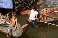 Cambodian family living on floating village in Tonle Sap Lake, Cambodia