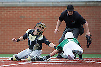 Wake Forest Demon Deacons catcher Logan Harvey (15) puts the tag on Reece Hampton (2) of the Charlotte 49ers as home plate umpire Gary Swanson looks on at Hayes Stadium on March 16, 2016 in Charlotte, North Carolina.  The 49ers defeated the Demon Deacons 7-6.  (Brian Westerholt/Four Seam Images)