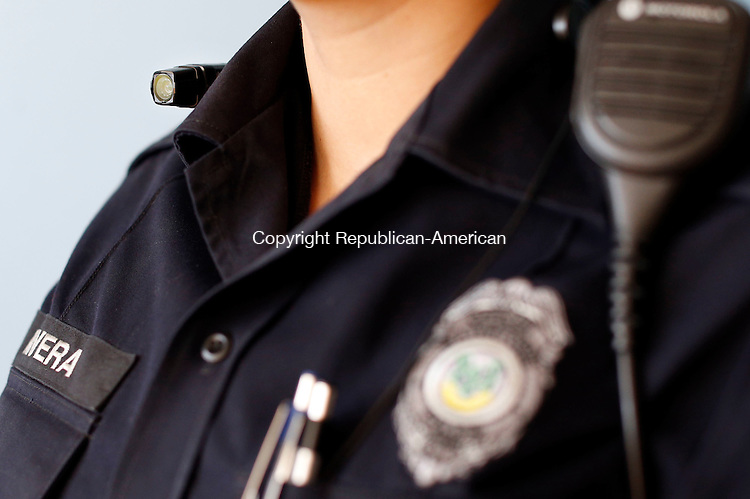 Watertown, CT- 13 February 2015-021315CM03-<br /> Watertown police officer Avelina Rivera demonstrates a Taser Axon Flex body camera, inside the police department in Watertown on Friday.  Police departments in Connecticut have been moving toward in using body cameras to provide a evidence which record video and audio. Christopher Massa Republican-American