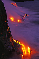 Glowing lava flow reaching the sea, Hawaii Volcanoes National Park