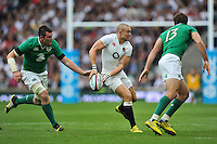 Mike Brown of England looks to pass the ball. QBE International match between England and Ireland on September 5, 2015 at Twickenham Stadium in London, England. Photo by: Patrick Khachfe / Onside Images